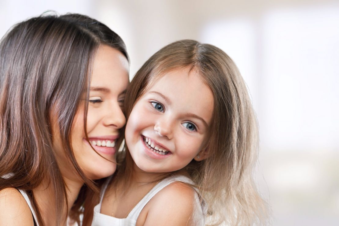 mother and daughter with healthy smile